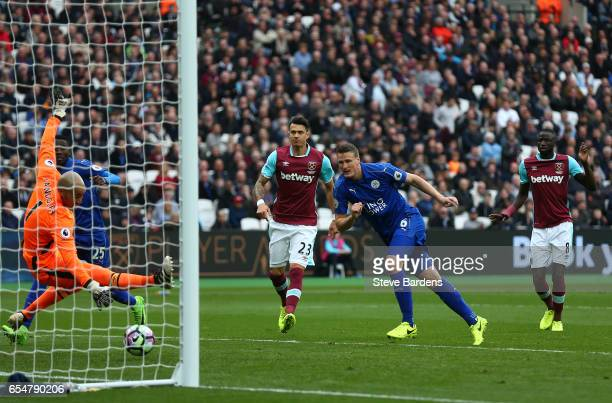 Robert Huth of Leicester City scores his sides second goal past Darren Randolph of West Ham United during the Premier League match between West Ham...