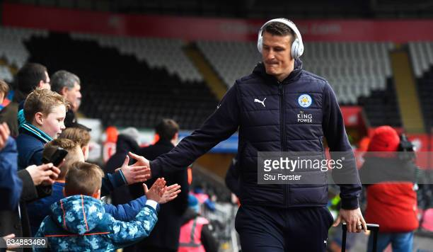 Robert Huth of Leicester City shakes hands with fans as he arrives prior to the Premier League match between Swansea City and Leicester City at...