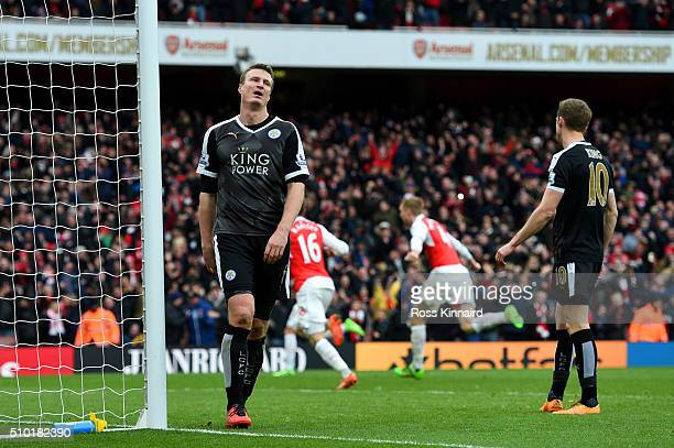 Robert Huth of Leicester City shows his dejection jafter conceding a goal during the Barclays Premier League match between Arsenal and Leicester City...