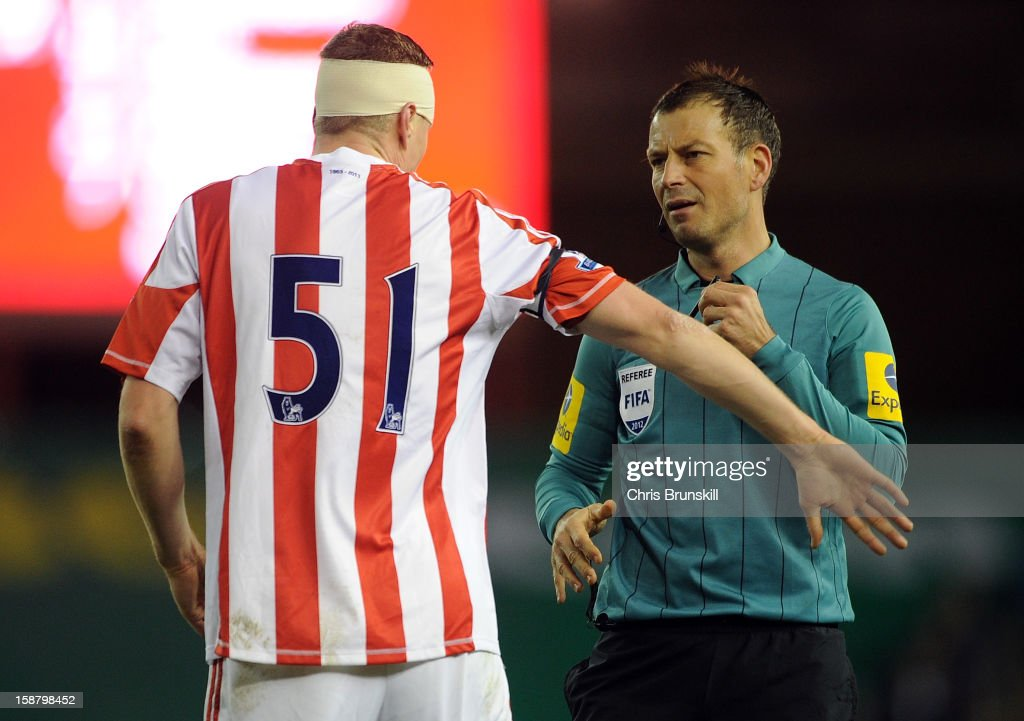Robert Huth (L) of Stoke City complains to referee Mark Clattenburg during the Barclays Premier League match between Stoke City and Southampton at Britannia Stadium on December 29, 2012 in Stoke on Trent, England.