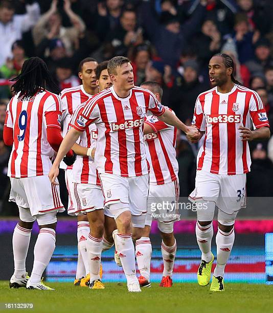 Robert Huth of Stoke City is congratulated by his teammates after scoring the opening goal during the Barclays Premier League match between Stoke...