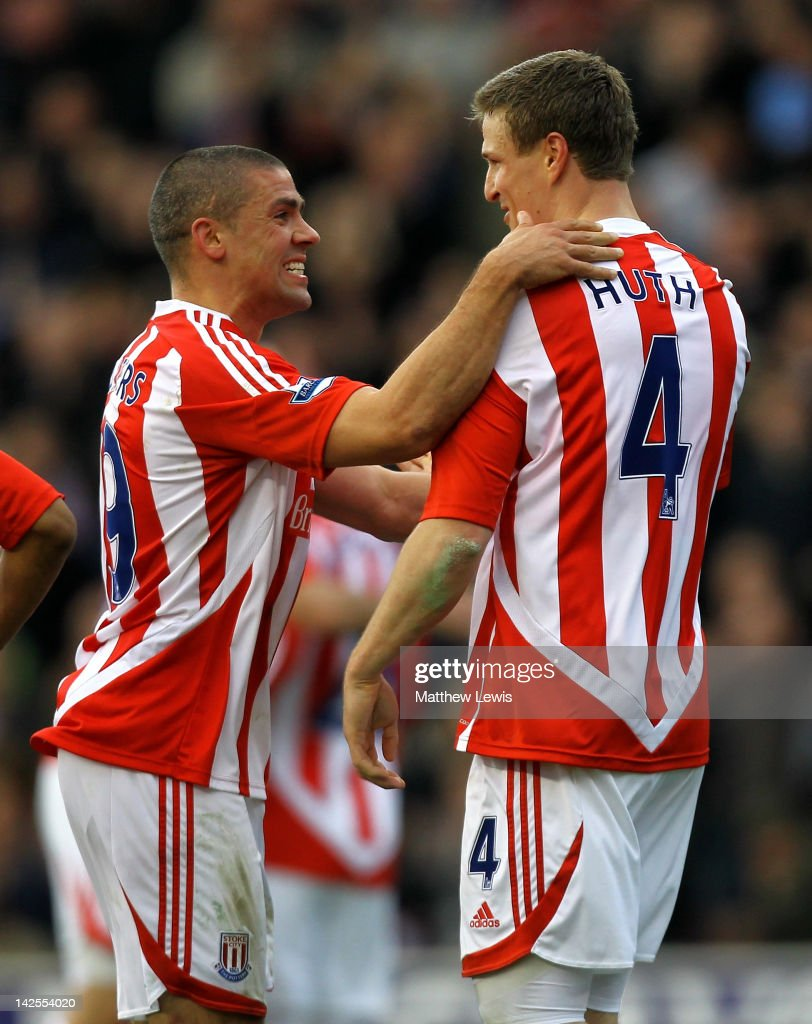 Robert Huth of Stoke City is congratulated by team mate Jonathan Walters (L) after scoring his team's first goal during the Barclays Premier League match between Stoke City and Wolverhampton Wanderers at the Britannia Stadium on April 7, 2012 in Stoke on Trent, England.