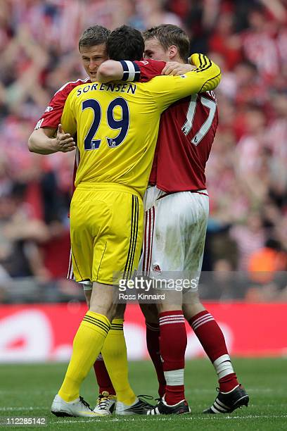 Robert Huth Thomas Sorensen and Ryan Shawcross of Stoke celebrate the fourth goal during the FA Cup sponsored by EON semi final match between Bolton...