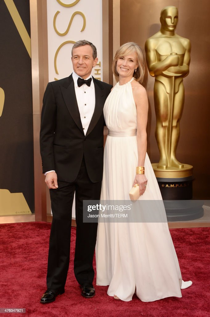 Robert Iger Chairman CEO of The Walt Disney Company and wife Willow Bay attends the Oscars held at Hollywood Highland Center on March 2 2014 in...