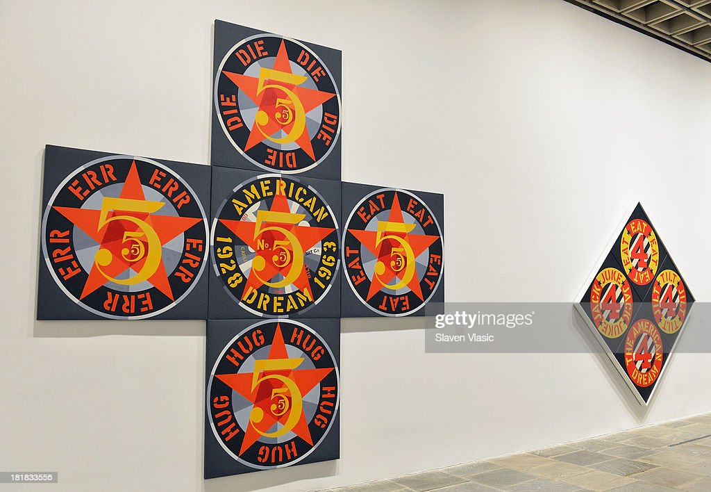 Robert Indiana's 'The Demuth American Dream #5'(L) and 'Bevare-Danger American Dream #4' oil on canvas, a part of 'Robert Indiana: Beyond Love' exibition on display at The Whitney Museum of American Art on September 25, 2013 in New York City.