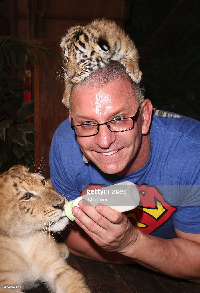 Robert Irvine feeds baby animals at the Fun And Fit As A Family Sponsored By Carnival Featuring Goya Kidz Kitchen Hosted By Robert Irvine during the Food Network South Beach Wine & Food Festival at Jungle Island on February 22, 2014 in Miami, Florida.