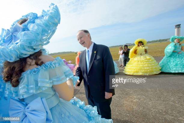Robert J Bentley Governor of Alabama enters the ground breaking ceremony for the Airbus A320 at Brookley Aeroplex as ladies with the Mobile Azalea...
