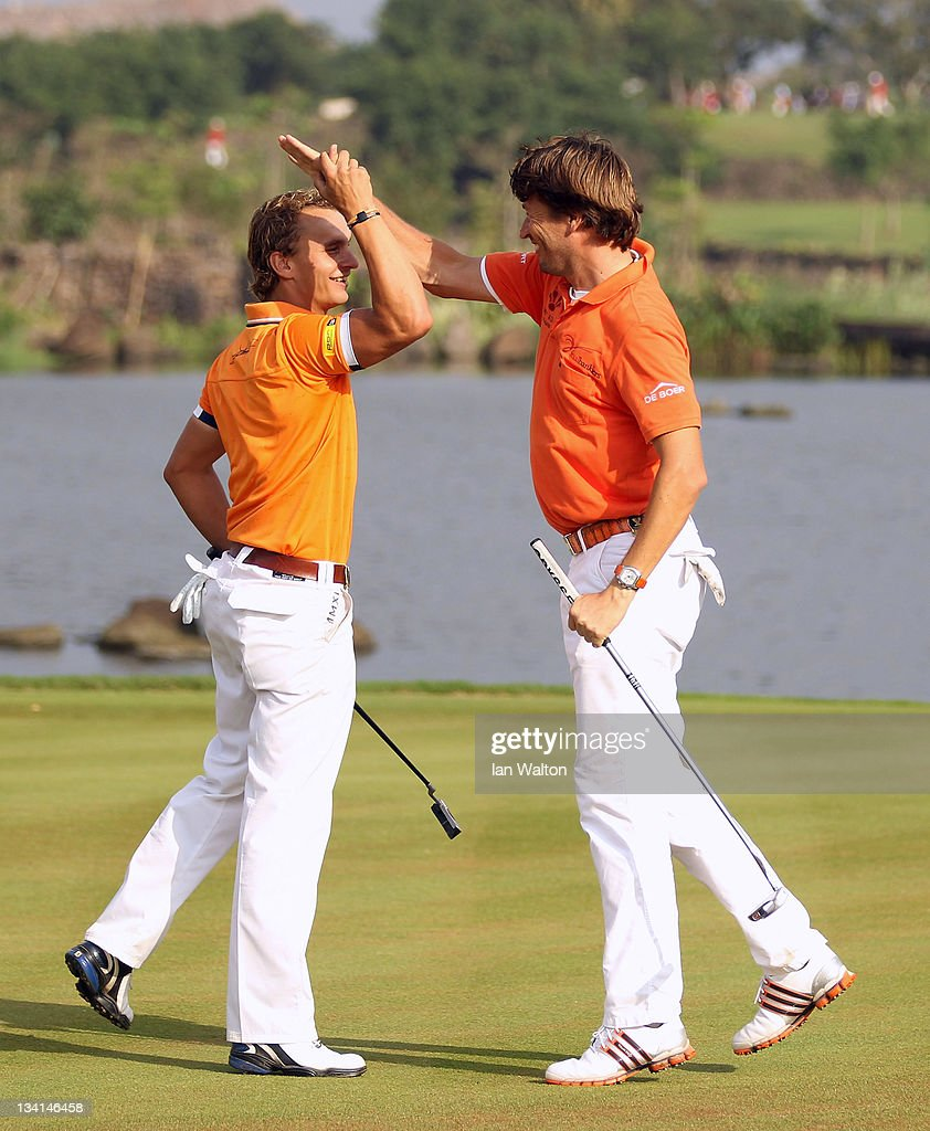 Robert Jan Derksen and Joost Luiten of The Netherlands celebrates on the 18th green during the foursomes on the final day of the Omega Mission Hills...
