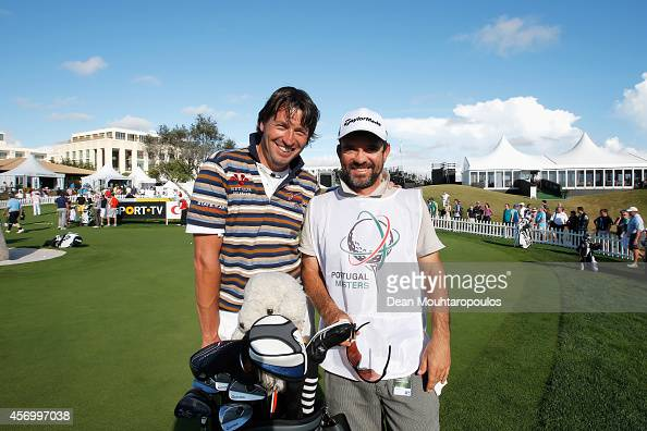 Robert Jan Derksen of The Netherlands and his caddie Janni Basson pose on the putting practice green during Day 2 of the Portugal Masters held at the...