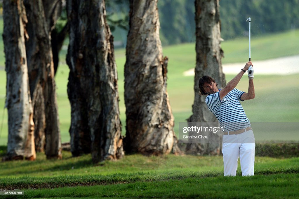 Robert Jan Derksen of The Netherlands plays a shot on the 9th hole during the first round of the 2014 Hong Kong Open at The Hong Kong Golf Club on...