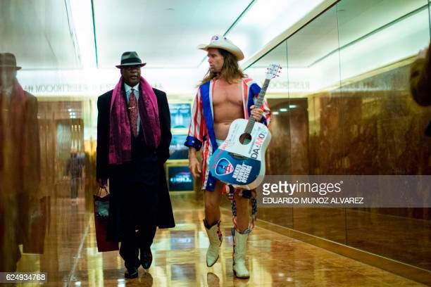 Robert John Burck better known as the 'Naked Cowboy' walks inside Trump Tower on another day of meetings for Presidentelect Donald Trump November 21...