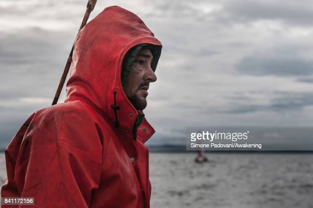 Robert Johnson junior looks the back of the trawler to see if the trawl net is pulling up properly on August 31 2017 near Edinburgh Scotland Port...