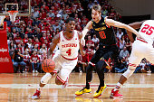 Robert Johnson of the Indiana Hoosiers dribbles around Jake Layman of the Maryland Terrapins in the first half of the game at Assembly Hall on...