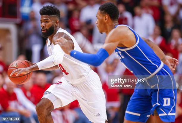 Robert Johnson of the Indiana Hoosiers dribbles the ball against Trevon Duval of the Duke Blue Devils at Assembly Hall on November 29 2017 in...