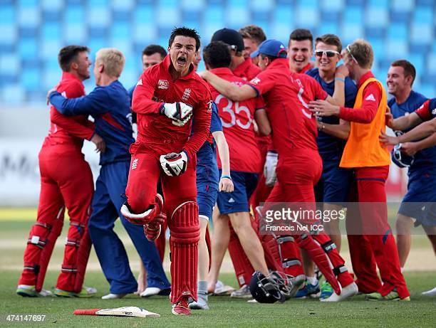 Robert Jones of England celebrates with teammates after winning the ICC U19 Cricket World Cup 2014 Quarter Final match between England and India at...