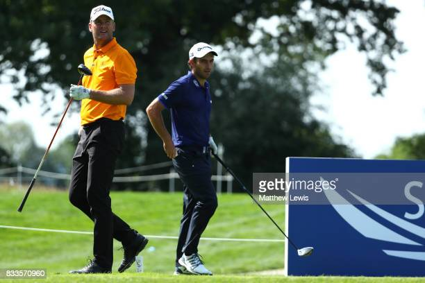 Robert Karlsson of Sweden and Edoardo Molinari of Italy look down the 3rd hole during round one of the Saltire Energy Paul Lawrie Matchplay at Golf...