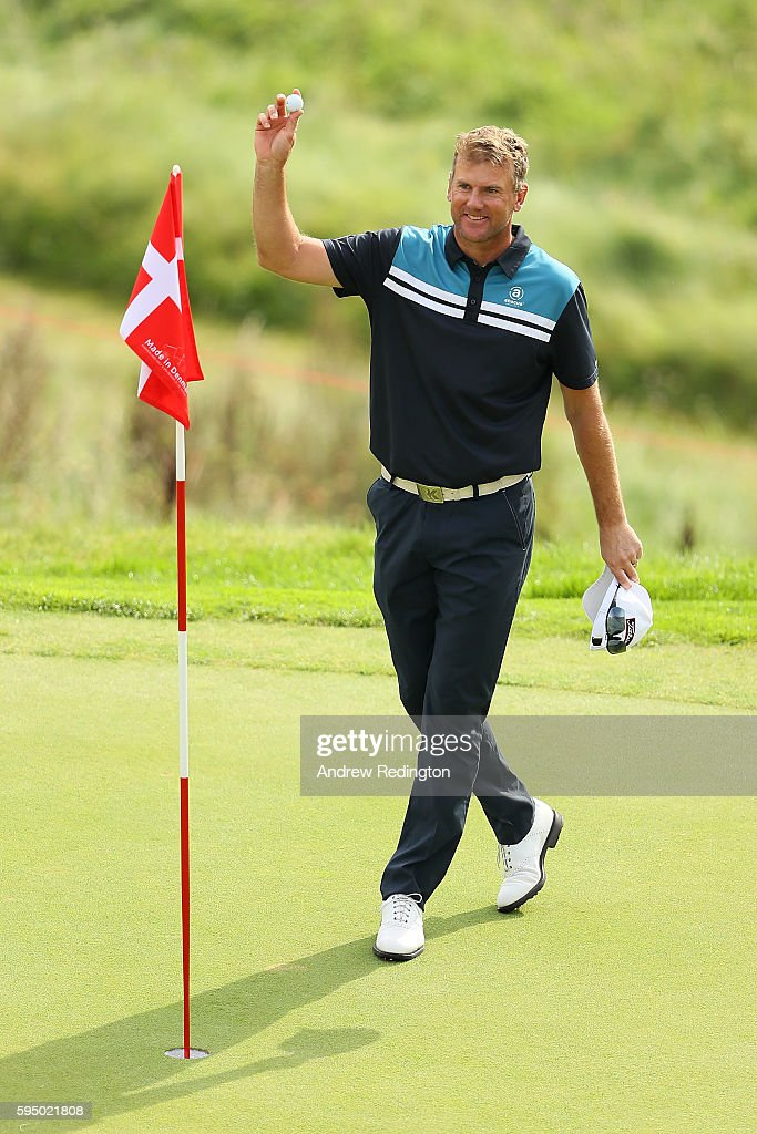 Robert Karlsson of Sweden celebrates a hole in one on the 16th hole during the first round of Made in Denmark at Himmerland Golf Spa Resort on August...