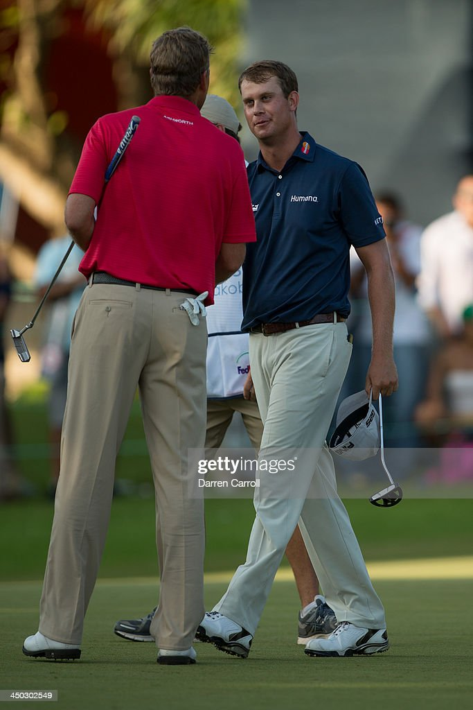 Robert Karlsson of Sweden congratulates Harris English of the United States at the 18th hole during the final round of the 2013 OHL Classic at Mayakoba, played at El Camaleon Golf Club on November 17, 2013 in Playa Del Carmen, Mexico.