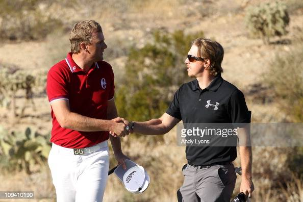 Robert Karlsson of Sweden congratulates Hunter Mahan on his win on the 18th hole during the second round of the Accenture Match Play Championship at...