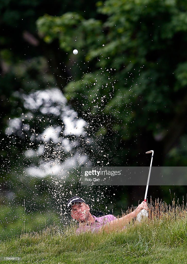 Robert Karlsson of Sweden hits a shot from a bunker on the 14th hole during Round One of the 113th U.S. Open at Merion Golf Club on June 13, 2013 in Ardmore, Pennsylvania.