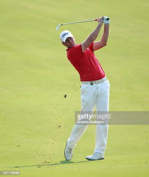 Robert Karlsson of Sweden hits his second shot on the 12th hole during the final round of the Dubai World Championship on the Earth Course Jumeirah...