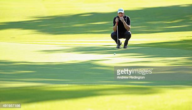 Robert Karlsson of Sweden lines up a putt on the 18th hole during the second round of the British Masters supported by Sky Sports at Woburn Golf Club...