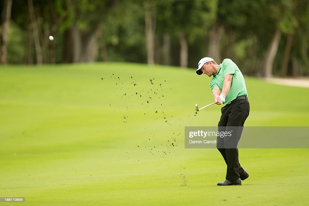 Robert Karlsson of Sweden plays an approach shot at the sixth hole during continuation of the first round of the 2013 OHL Classic at Mayakoba, played at El Camaleon Golf Club on November 15, 2013 in Playa Del Carmen, Mexico.