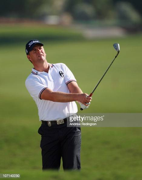Robert Karlsson of Sweden plays his fourth shot on the 18th hole hole during the first round of the Dubai World Championship on the Earth Course...