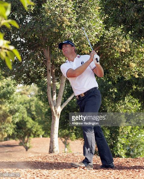 Robert Karlsson of Sweden plays his second shot on the 18th hole hole during the first round of the Dubai World Championship on the Earth Course...