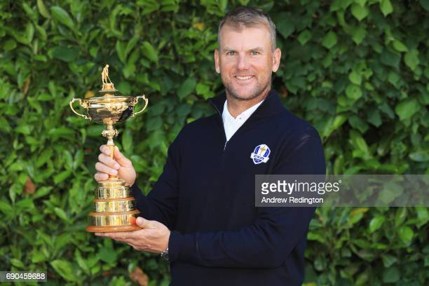 Robert Karlsson of Sweden poses with the Ryder Cup trophy as he is announced as Ryder Cup ViceCaptain for France 2018 at Wentworth on May 22 2017 in...