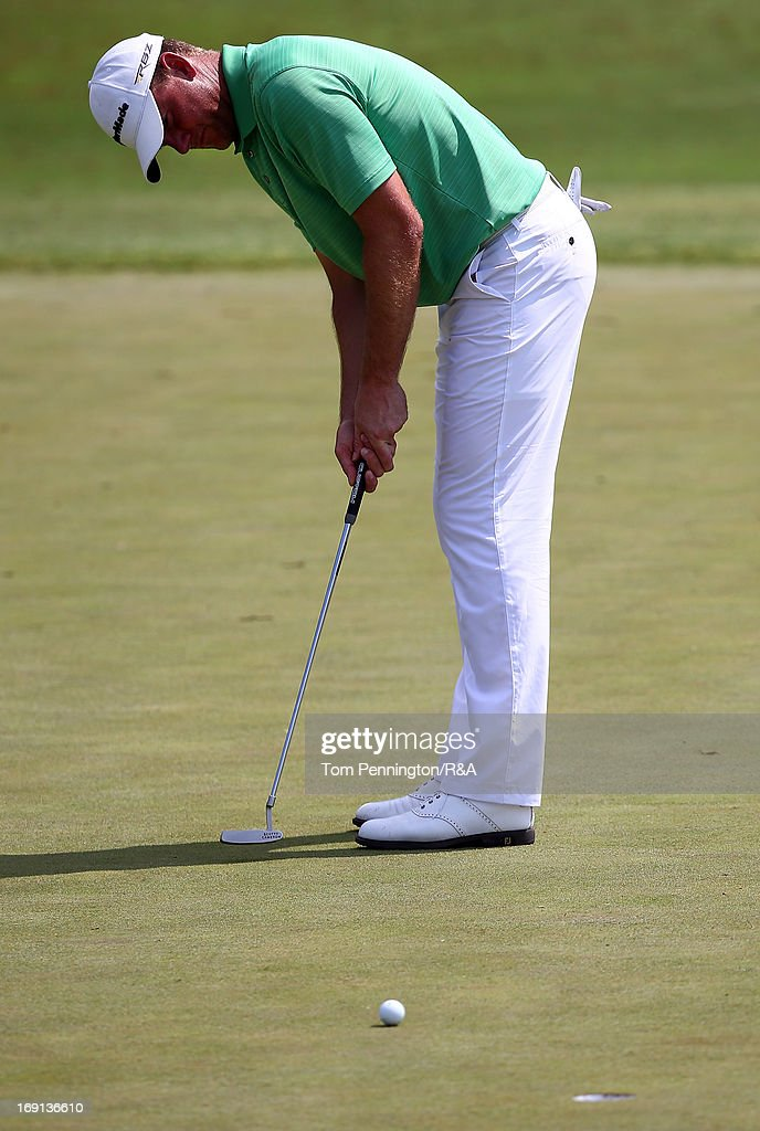 <a gi-track='captionPersonalityLinkClicked' href=/galleries/search?phrase=Robert+Karlsson&family=editorial&specificpeople=214653 ng-click='$event.stopPropagation()'>Robert Karlsson</a> of Sweden putts the ball during The Open Championship International Final Qualifying America at Gleneagles Golf and Country Club on May 20, 2013 in Plano, Texas.