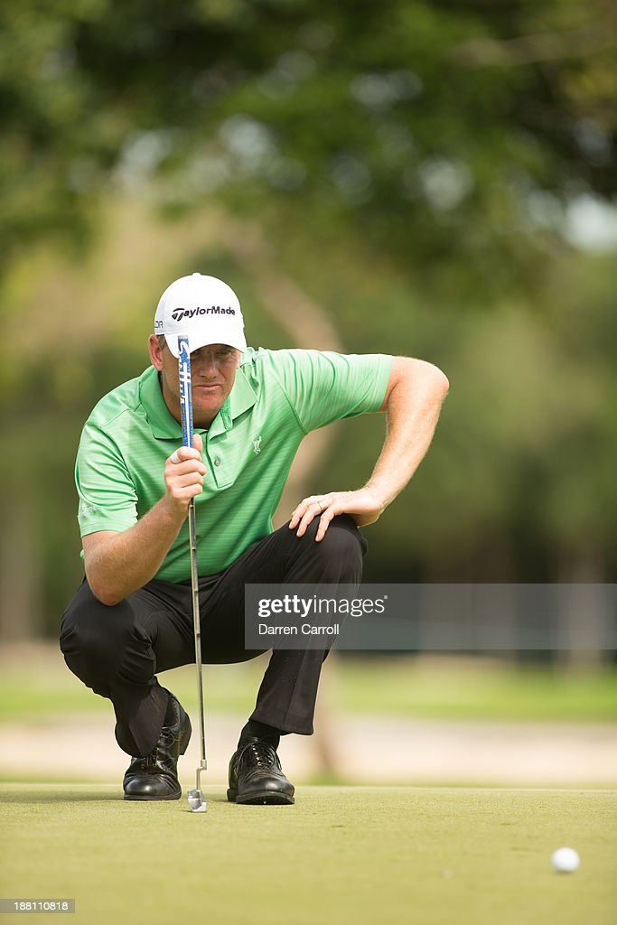 Robert Karlsson of Sweden reads a putt at the ninth hole during continuation of the first round of the 2013 OHL Classic at Mayakoba, played at El Camaleon Golf Club on November 15, 2013 in Playa Del Carmen, Mexico.
