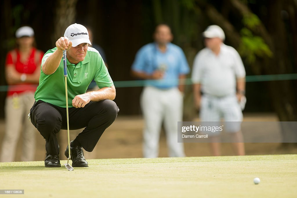 Robert Karlsson of Sweden reads a putt at the seventh hole during continuation of the first round of the 2013 OHL Classic at Mayakoba, played at El Camaleon Golf Club on November 15, 2013 in Playa Del Carmen, Mexico.