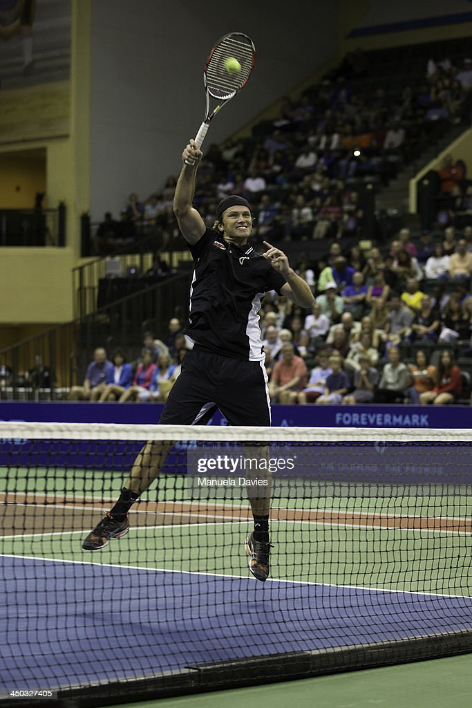 <a gi-track='captionPersonalityLinkClicked' href=/galleries/search?phrase=Robert+Kendrick&family=editorial&specificpeople=692506 ng-click='$event.stopPropagation()'>Robert Kendrick</a> of the U.S. hits a high volley during the exhibition doubles match against John Isner and Jean-Julien Rojer during the 2013 Mylan WTT Smash Hits on November 17, 2013 at the ESPN Wide World of Sports Complex in Lake Buena Vista, Florida.