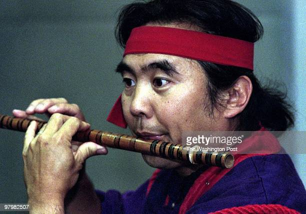 Robert KikuchYngojo a storyteller from San Francisco used rhythmic dialogs stylized movements Asian instruments and comic facial expresions inspired...