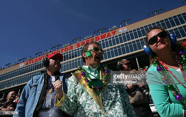 Robert Knotts celebrates St Patricks Day with Cheryl Greely and Bill Dobbs as they watch the NASCAR Busch Series Nicorette 300 at Atlanta Motor...