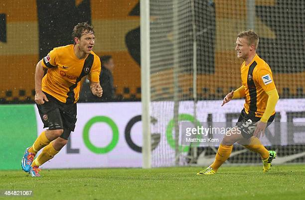 Robert Koch of Dresden jubilates after scoring the third goal during the Second Bundesliga match between SG Dynamo Dresden and TSV 1860 Muenchen at...