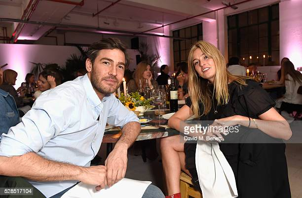 Robert Konjic and Camille Charriere attend a private dinner hosted by Mih Jeans to celebrate their 10th anniversary at Brewer Street Car Park on May...