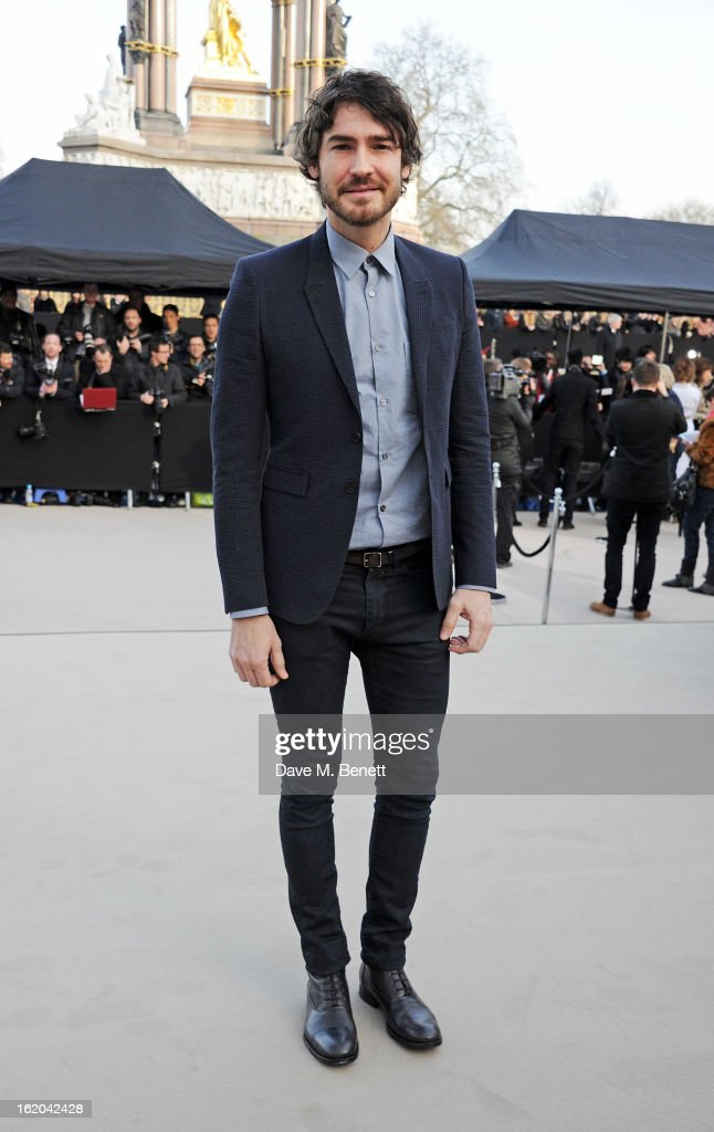 Robert Konjic arrives at the Burberry Prorsum 2013 Autumn Winter Womenswear Show at Kensington Gardens on February 18, 2013 in London, England.