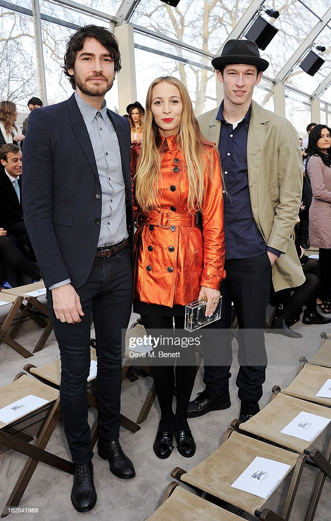 Robert Konjic, Harley Viera Newton and Callum Turner attend the Burberry Prorsum Autumn Winter 2013 Womenswear Show at Kensington Gardens on February 18, 2013 in London, England.