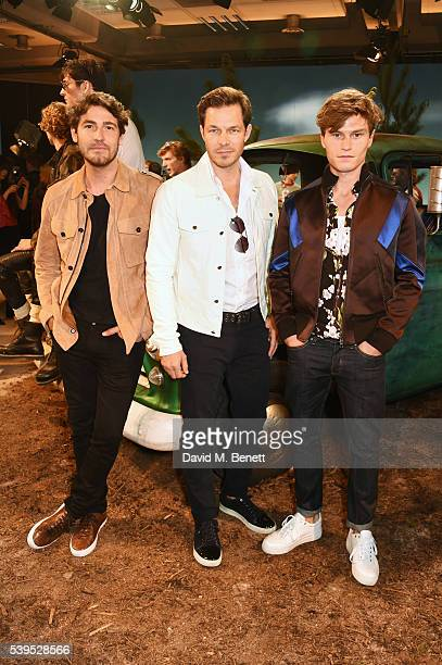 Robert Konjic Paul Sculfor and Oliver Cheshire attend the Belstaff presentation during The London Collections Men SS17 at QEII Centre on June 12 2016...