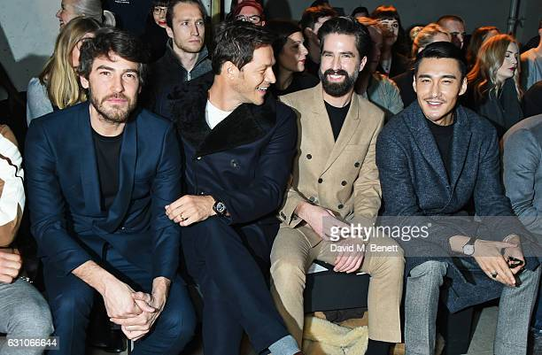 Robert Konjic Paul Sculfor Jack Guinness and Hu Bing attend the TOPMAN DESIGN show during London Fashion Week Men's January 2017 collections at the...