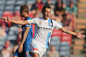 Robert Koren of Melbourne City celebrates scoring a goal with Jets player looking dejected in frame during the round 14 ALeague match between the...