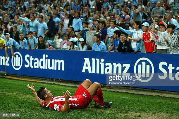 Robert Koren of Melbourne City FC reacts to fans after he was tackled over the sideline during the round one ALeague match between Sydney FC and...
