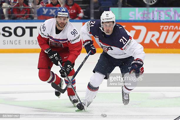 Robert Kousal of Czech Republic and Dylan Larkin of USA pursue the puck at Ice Palace on May 19 2016 in Moscow Russia