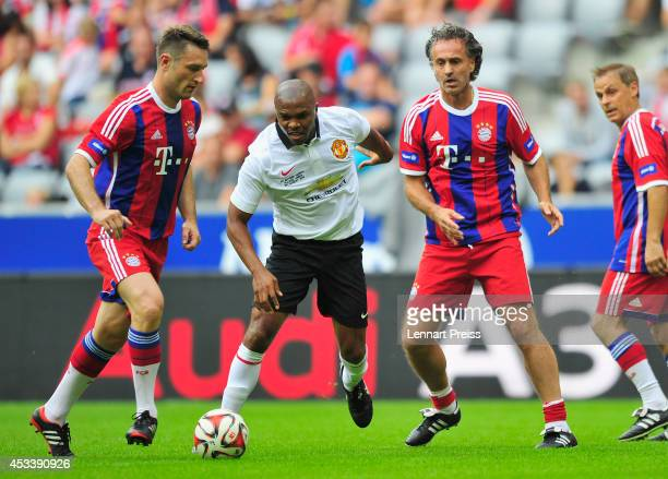 Robert Kovac and Maurizio Gaudino of FCB AllStars challenge Quinton Fortune of ManUtd Legends during the friendly match between FC Bayern Muenchen...