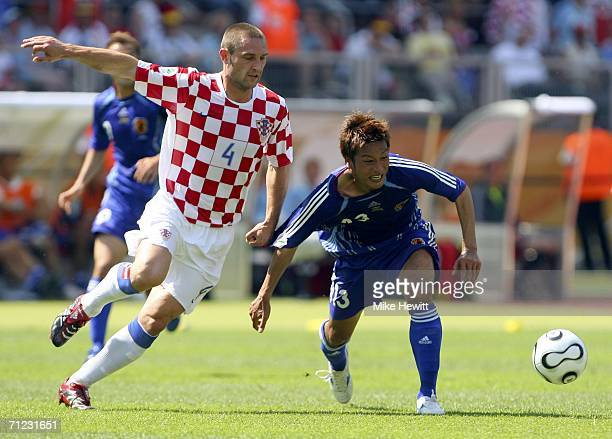 Robert Kovac of Croatia battles for the ball with Atsushi Yanagisawa of Japan during the FIFA World Cup Germany 2006 Group F match between Japan and...