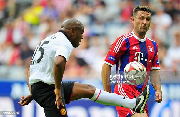 Robert Kovac of FCB AllStars challenges Quinton Fortune of ManUtd Legends during the friendly match between FC Bayern Muenchen AllStars and...
