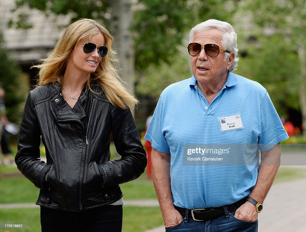 Robert Kraft, New England Patriots owner and Chairman and Chief Executive Officer of The Kraft Group, and actress named Ricki Noel Lander walk in Sun Valley Village during Allen & Co. annual conference on July 11, 2013 in Sun Valley, Idaho. The resort will host corporate leaders for the 31st annual Allen & Co. media and technology conference where some of the wealthiest and most powerful executives in media, finance, politics and tech gather for a weeklong meetings which begins Tuesday. Past attendees included Warren Buffett, Bill Gates and Mark Zuckerberg.