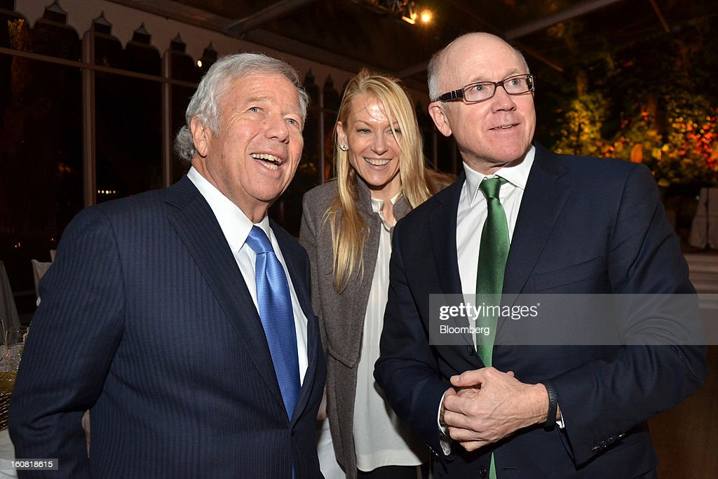 Robert Kraft, owner of the New England Patriots, from left, Suzanne Johnson and Woody Johnson, owner of the New Jersey Jets, are seen at a party hosted by Tom and Gayle Benson, owners of the New Orleans Saints, for NFL team owners in New Orleans, Louisiana, U.S., on Thursday, Jan. 31, 2013. The party in City Park kicked off a weekend of festivities before Super Bowl XLVII. Photographer: Amanda Gordon/Bloomberg via Getty Images